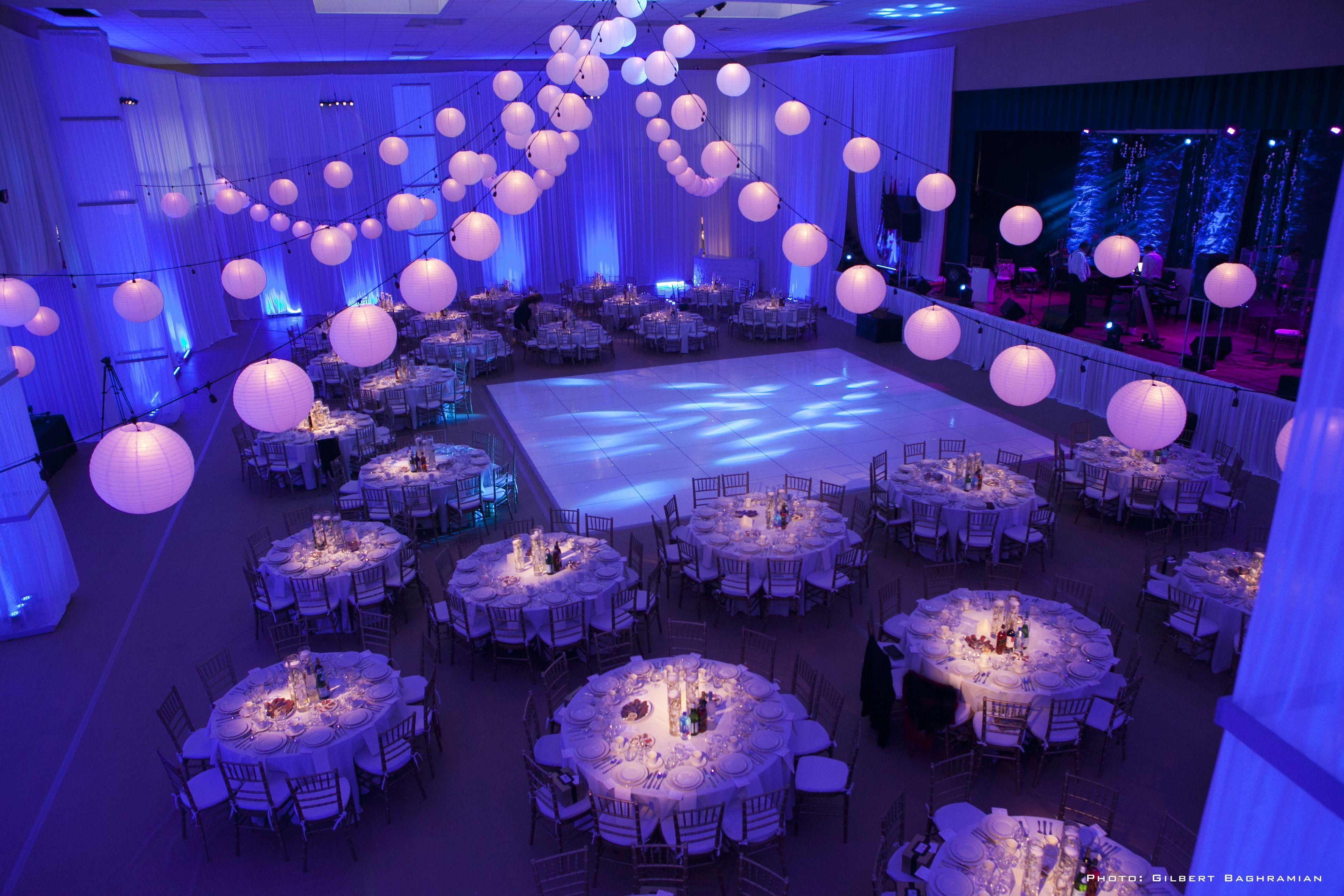 Fancy indoor wedding reception decoration idea using paper lanterns