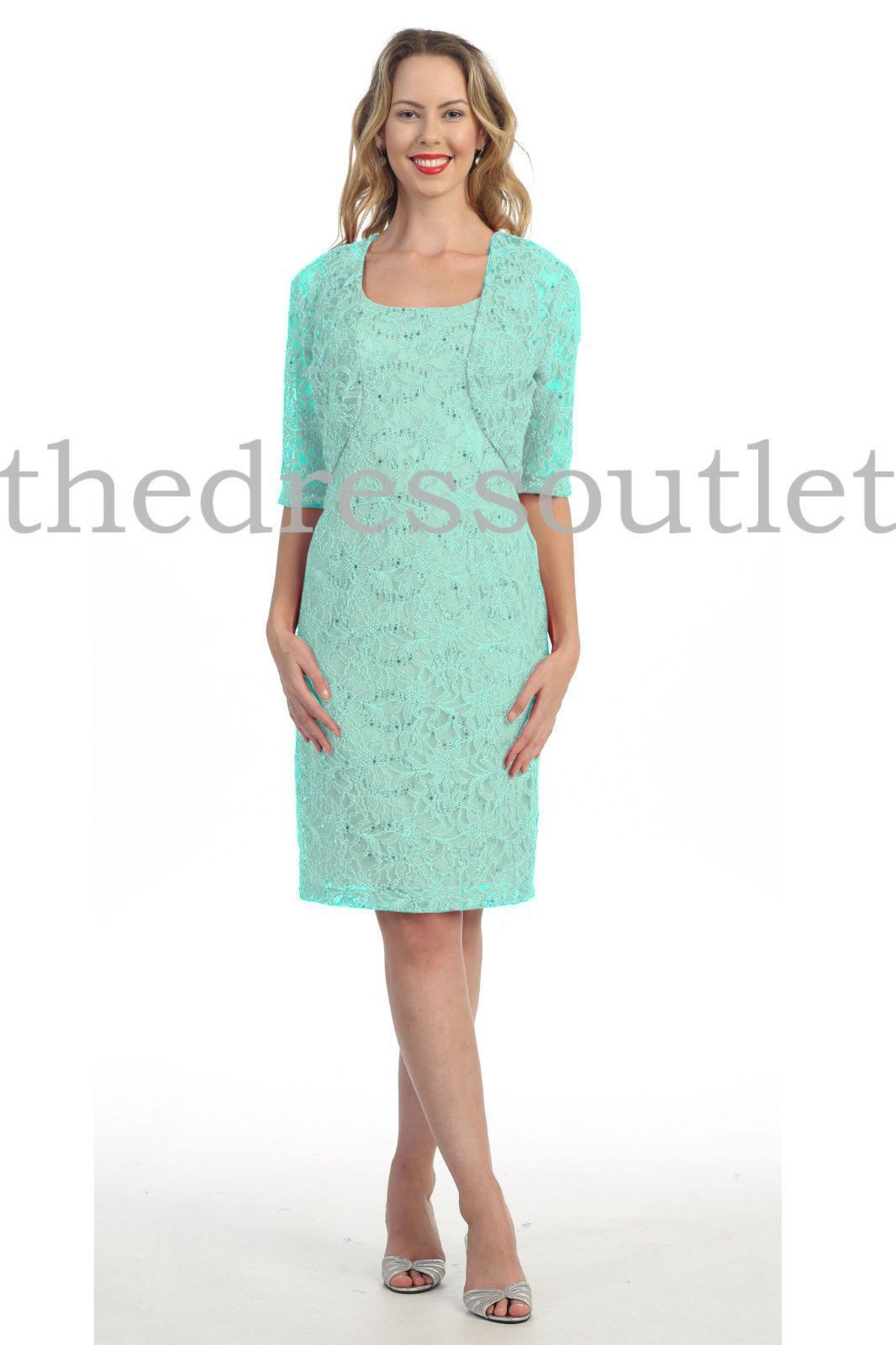 This elegant mother of the bride short dress features sleeveless ...