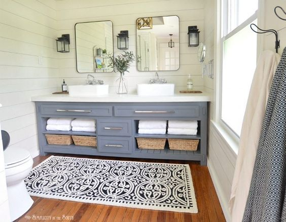 A bedroom is turned into a modern farmhouse style master bathroom on