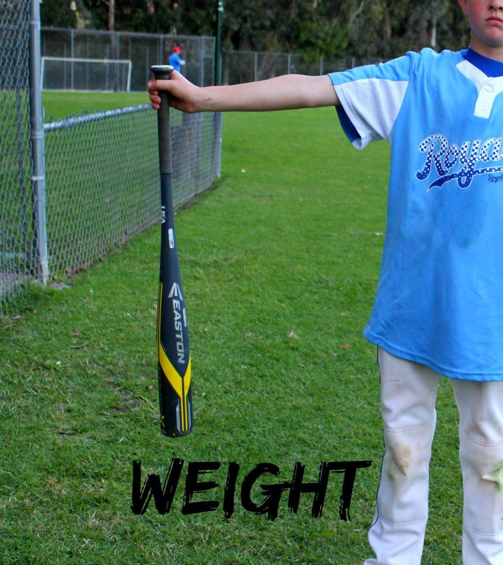 Example Of Child Holding Out Bat To Test Weight Baseballbats