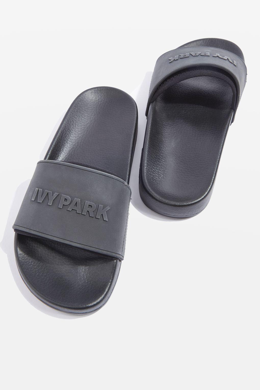 4d057536fe0408 Embossed Logo Slider Shoes by Ivy Park