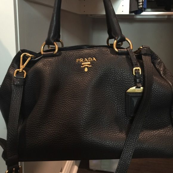 Authentic Prada Daino totes Beautiful gold hardware Prada for sale.  Authenticity guaranteed. Black leather. Gently used. 3 compartments. 8680eacda7ff7