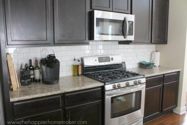 White Kitchen Cabinets With Dark Tile Backsplash