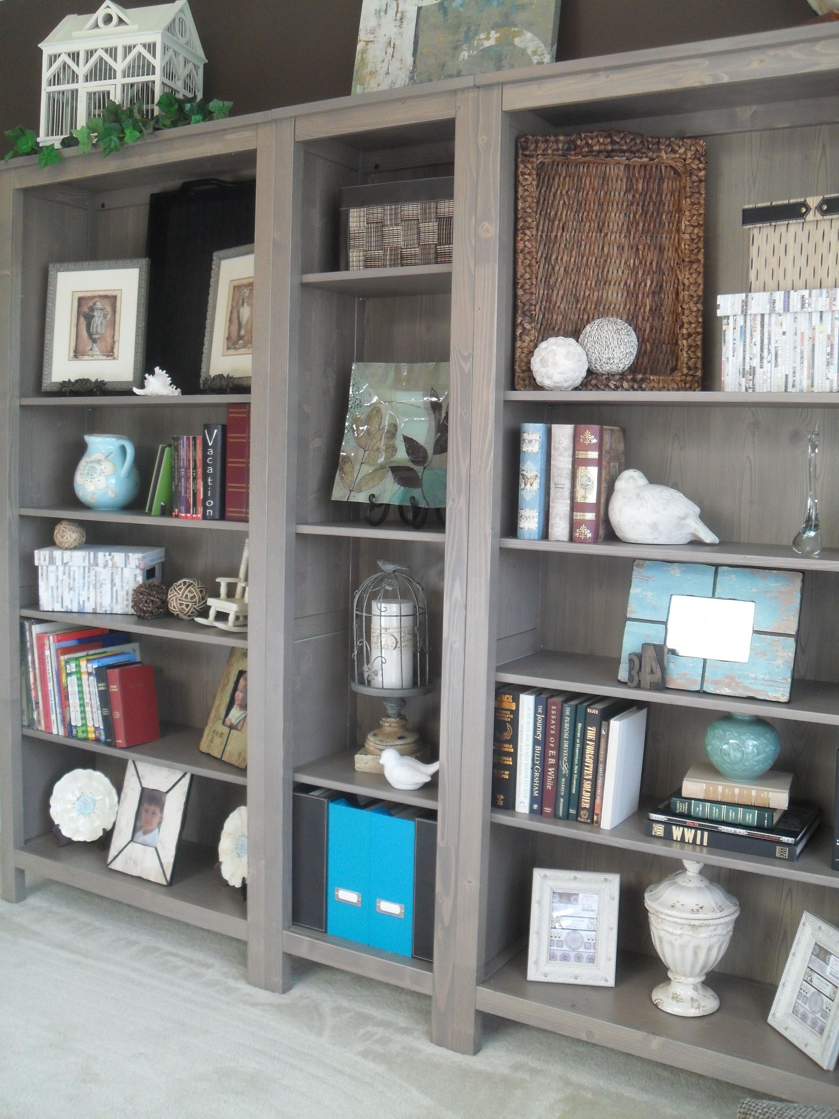 ikea hemnes bookshelves in grey brown dining room turned library