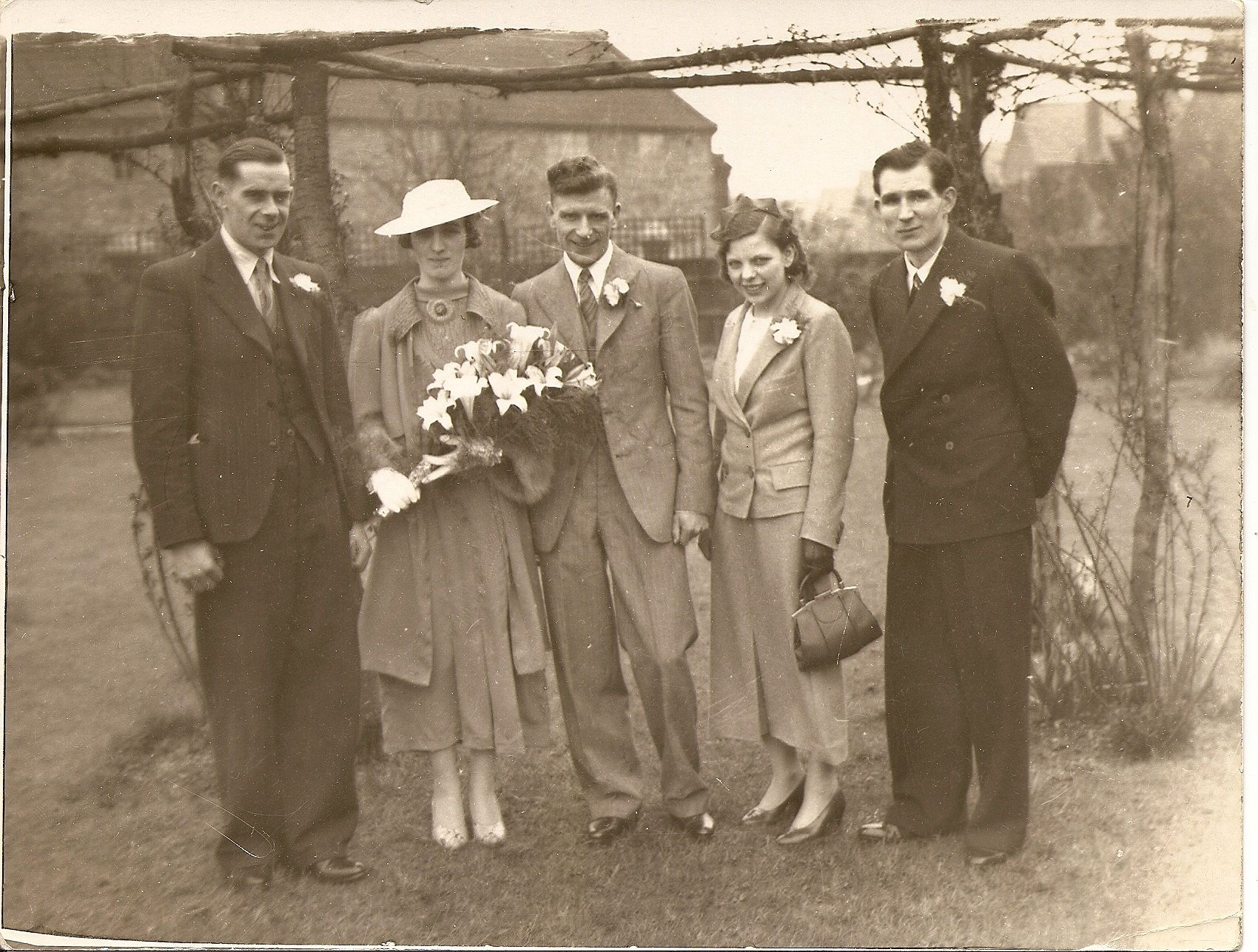 Bride and groom and siblings maybe names date