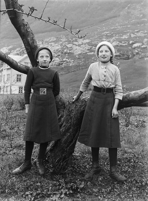 I love the shorter, narrow skirts, and the knitted sweater underneath the jumper on the right.
