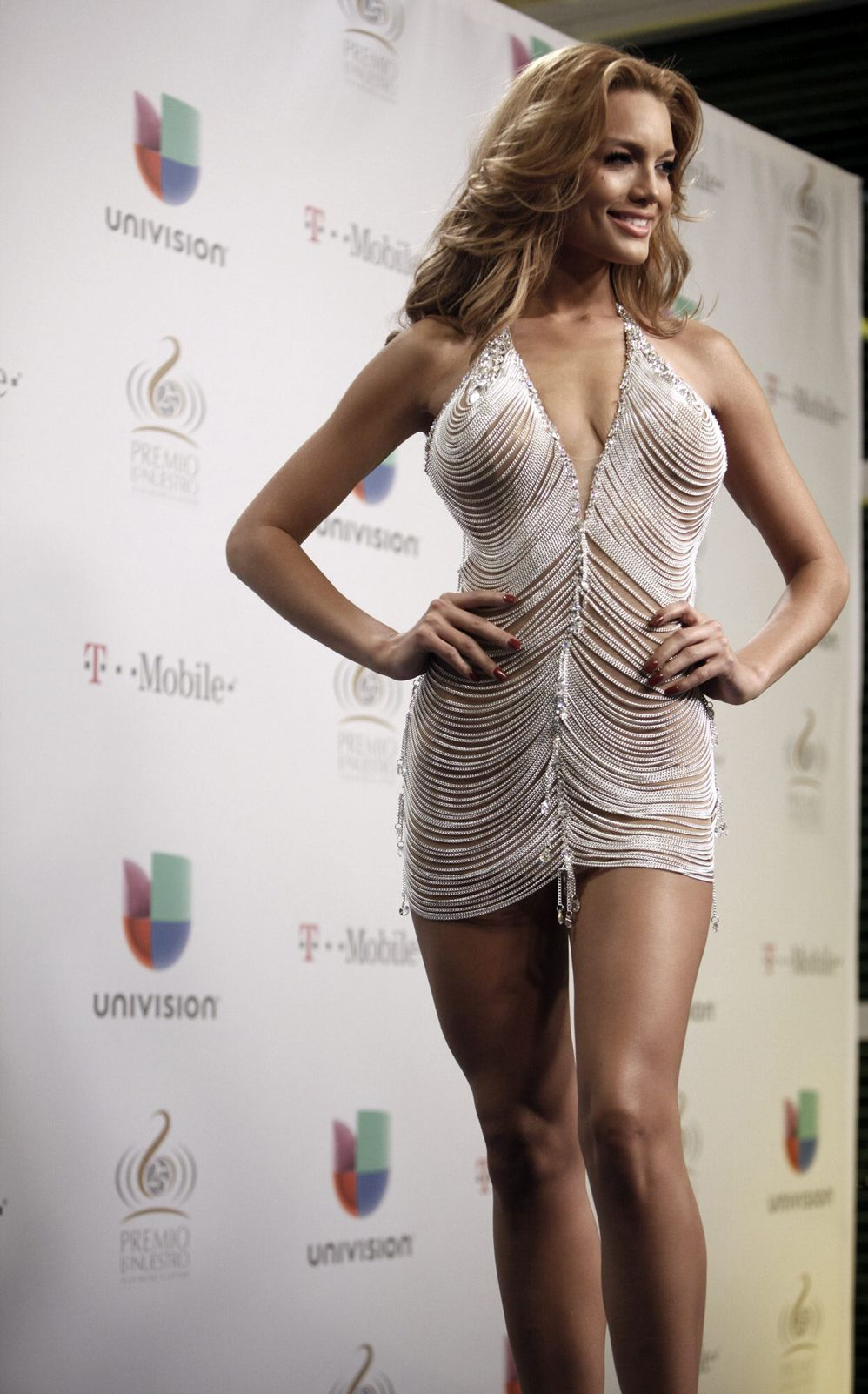 Zuleika Rivera, former Miss Universe from Puerto Rico at Premios lo Nuestro, Univisión. She cut off her evening gown from the Miss Universe Pageant.