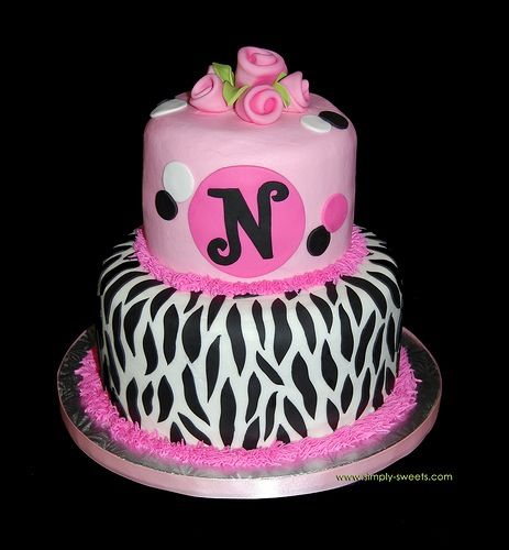 a pink cake 3 levels zebra print and letter n