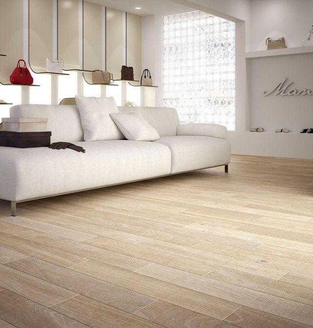 La calidez de la madera de manos del suelo porcel nico for Azulejo de parquet negro imitacion