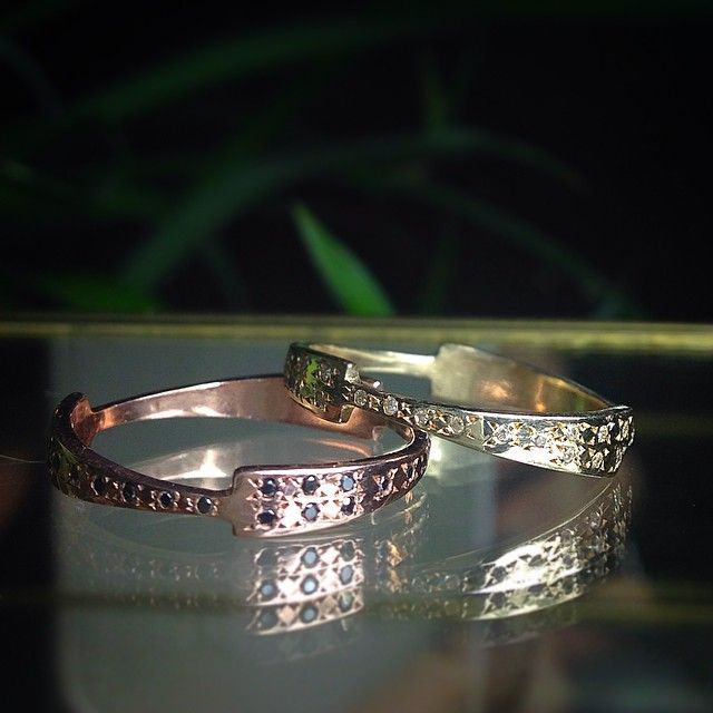 Fuse eternity bands.  Evening photoshoot taken by @ilanakruger #eternity #yellowgold #rosegold #diamonds #whitediamonds #blackdiamonds #wedding #stacks #tkahresjewelry #studio