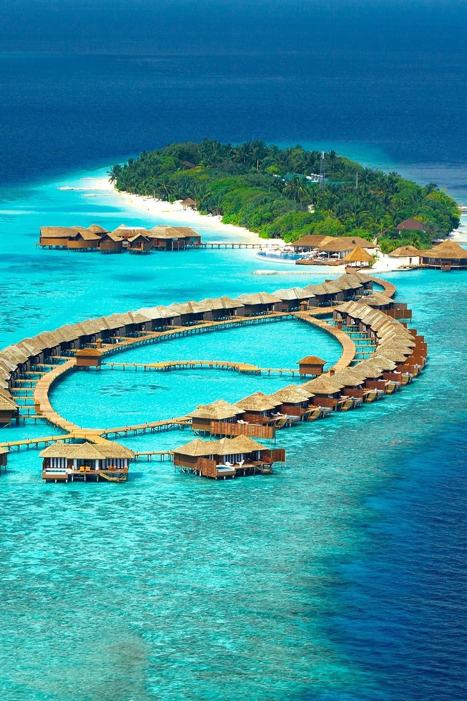 Lily beach resort in the maldives located on the tropical for Best beach resorts in the world