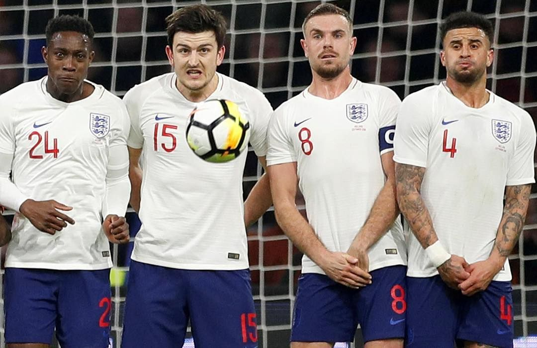 england s danny welbeck harry maguire jordan henderson and kyle walker face up to a free kick from memphis depay photo acti free kick kicks funny photoshop england s danny welbeck harry maguire