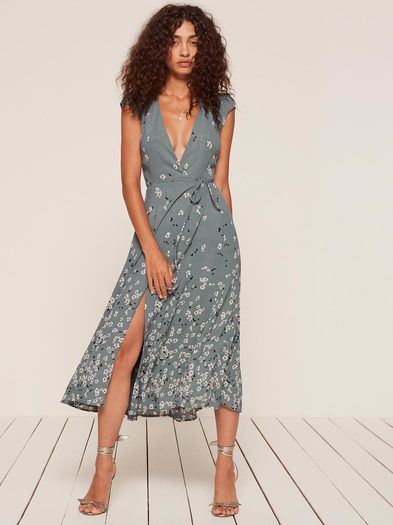 3f5c2b4e2fc82 For that thing this weekend. This is a midi length, wrap dress with a high  slit, a deep v neckline and a cap sleeve.