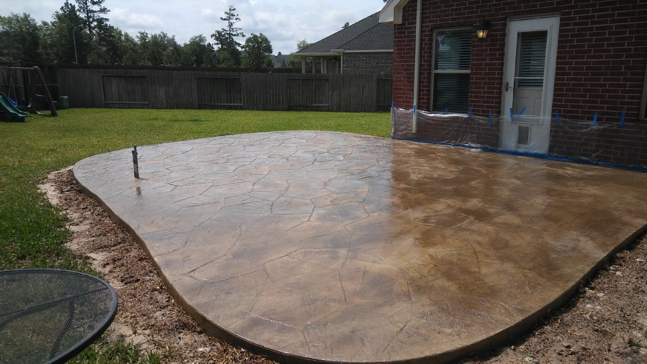 Beautiful Stamped Concrete Patio With Flagstone Pattern And Leather Brown  Stain In Cypress, Texas.
