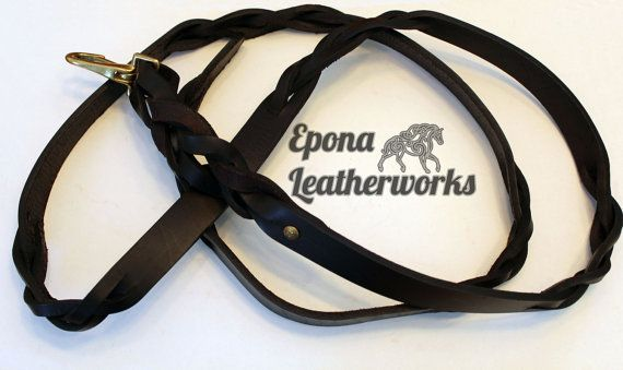 Hand braided from head to toe, this lead sports 6 of our signature braids and our twist by the snap. $70.00