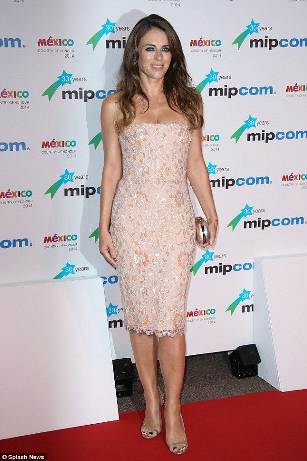 Bust enough: Elizabeth Hurley dazzles at the premiere for new television series The Royals at MIPCOM in Cannes, France on Monday evening