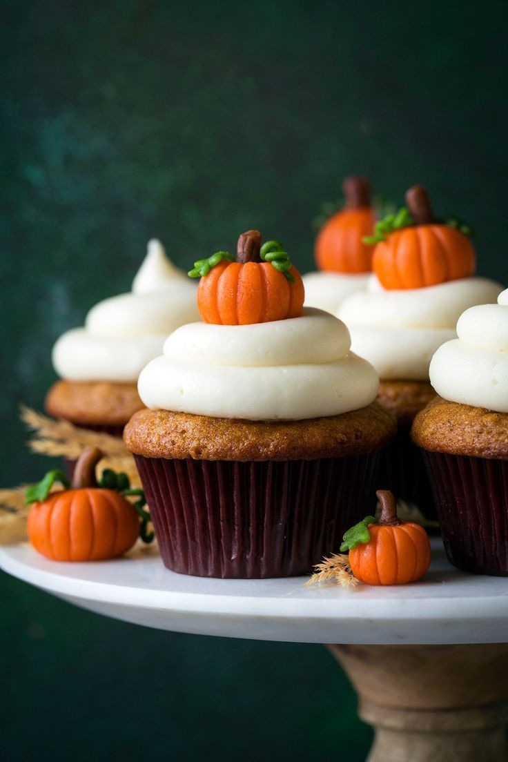 These are the BEST Pumpkin Cupcakes and that Cream Cheese Frosting is divine! #halloween #halloweenfood #halloweendesserts #desserts #sweets #halloweenrecipes #recipes