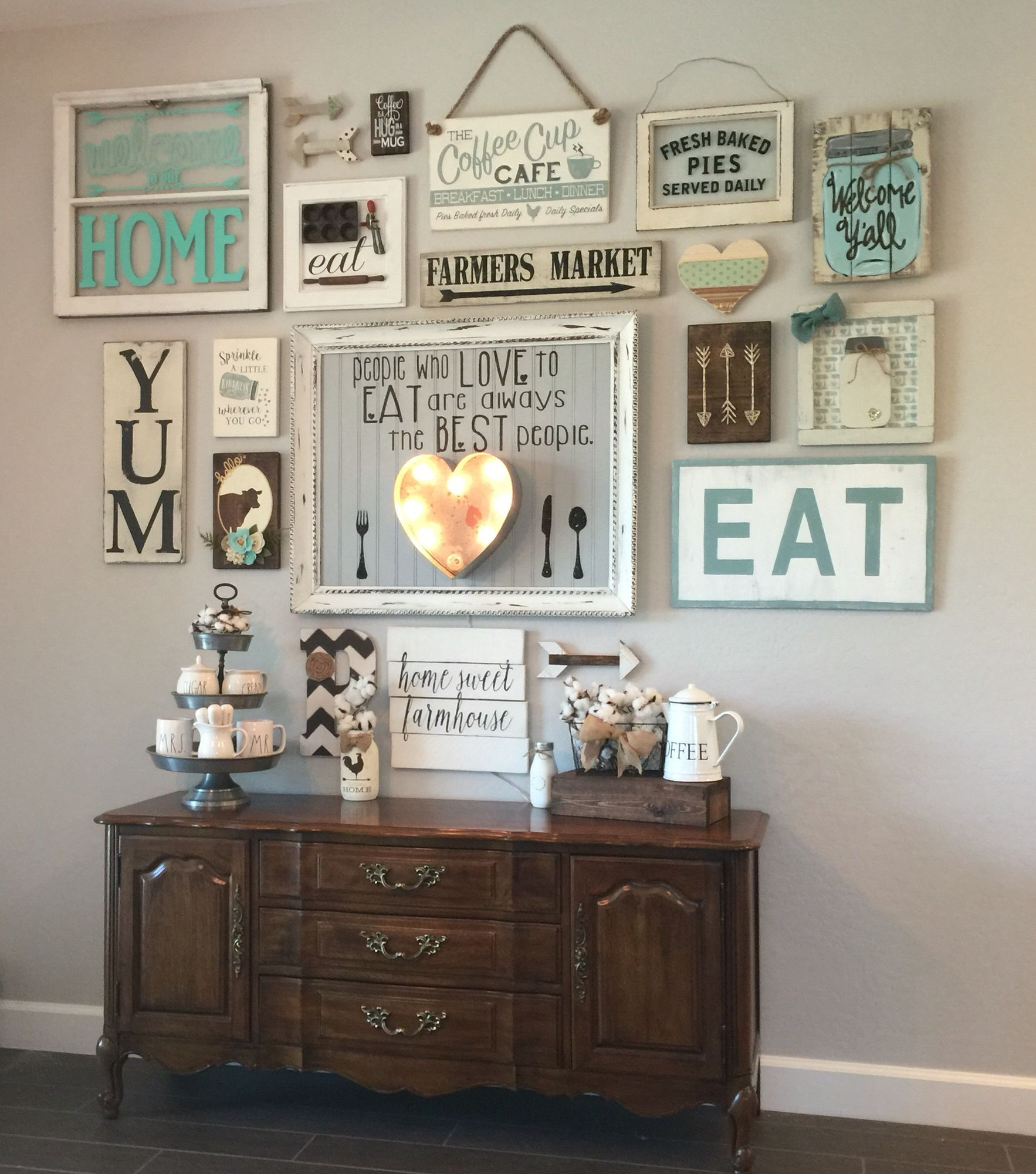 My gallery wall in our kitchen i 39 m colewifey on ig for Wall hanging ideas for dining room