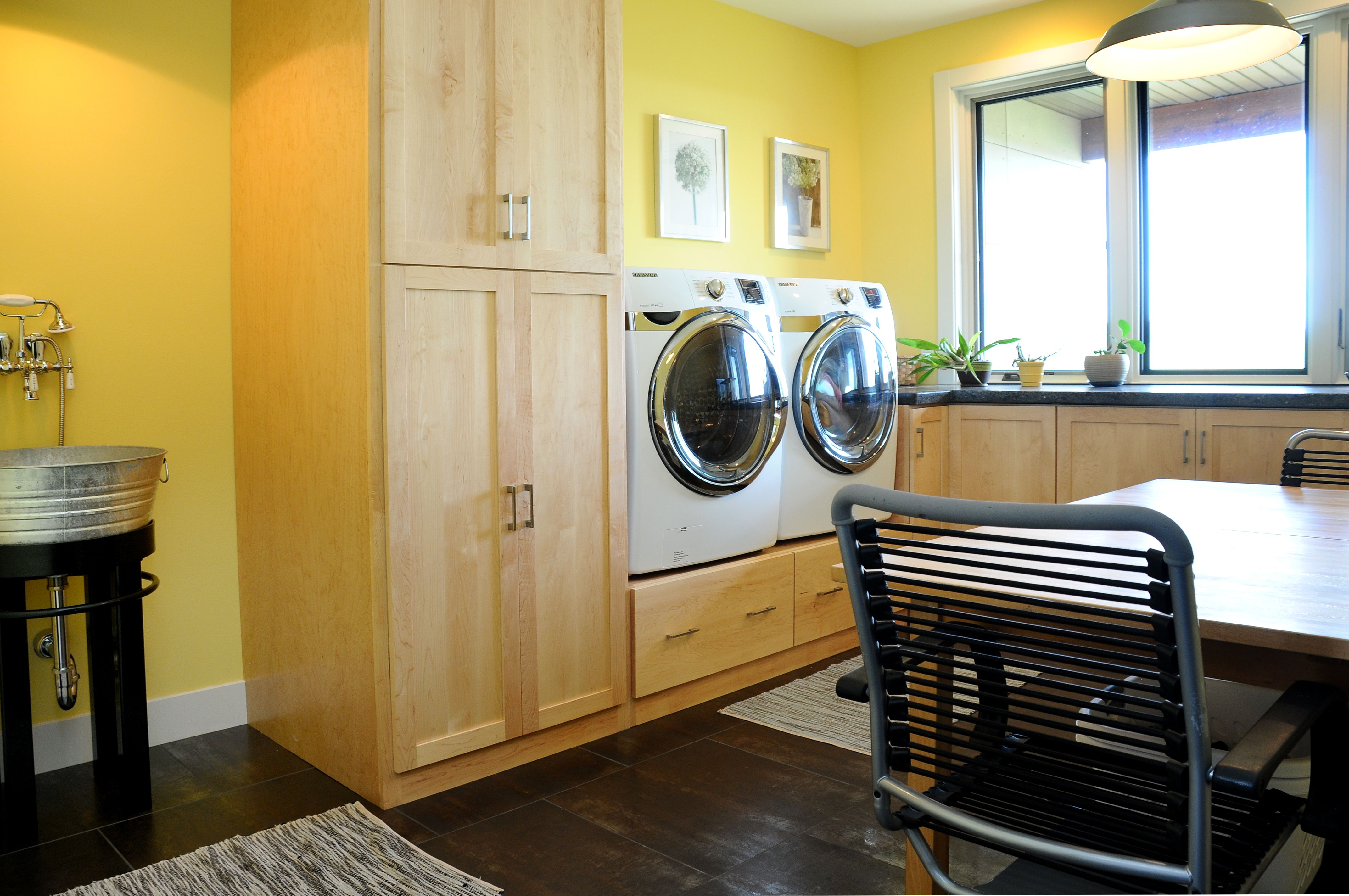 Laundry room with rustic wash basin sink and maple ...
