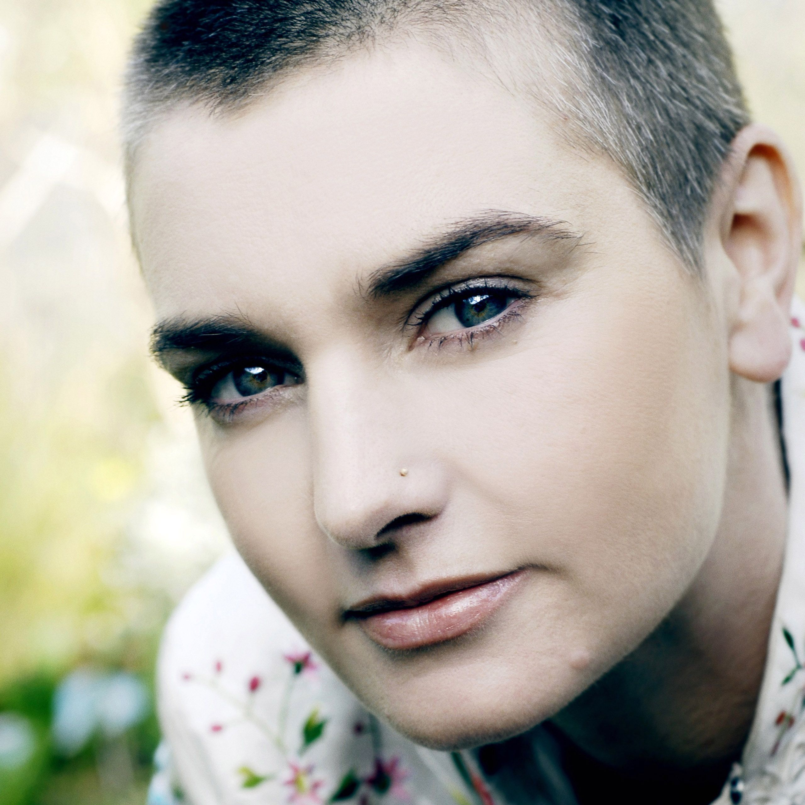 Sinead O'Connor is one rare woman who, with a crew cut, just looks stunning.  She has the most compelling eyes and that wonderful Irish colouring . . . fair skin, blue-blue eyes and very dark hair.