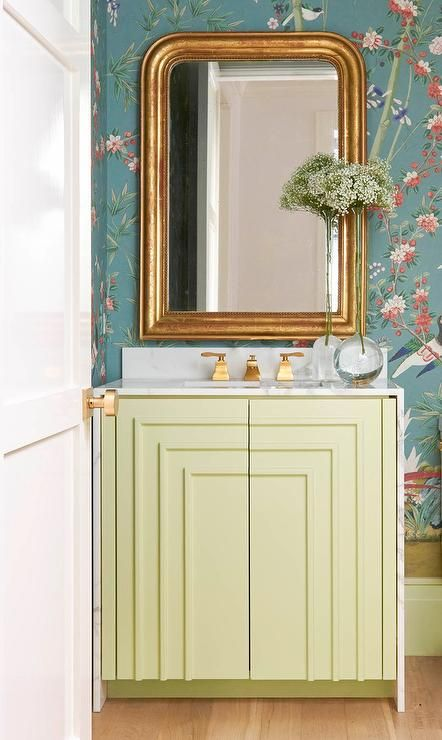 powder room boasts a wall clad in peacock blue