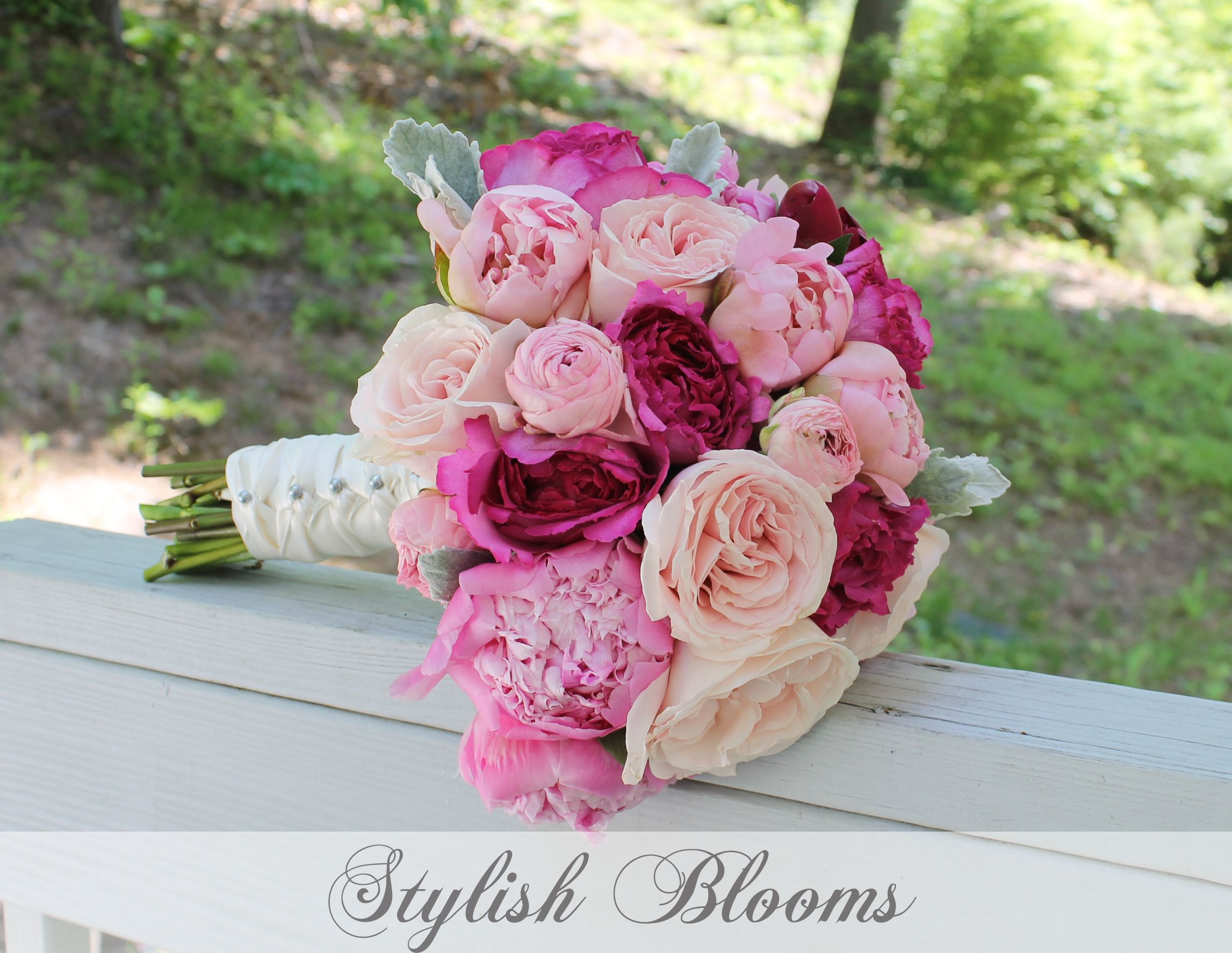 hot pink and light pink garden roses, peonies and ranunculus