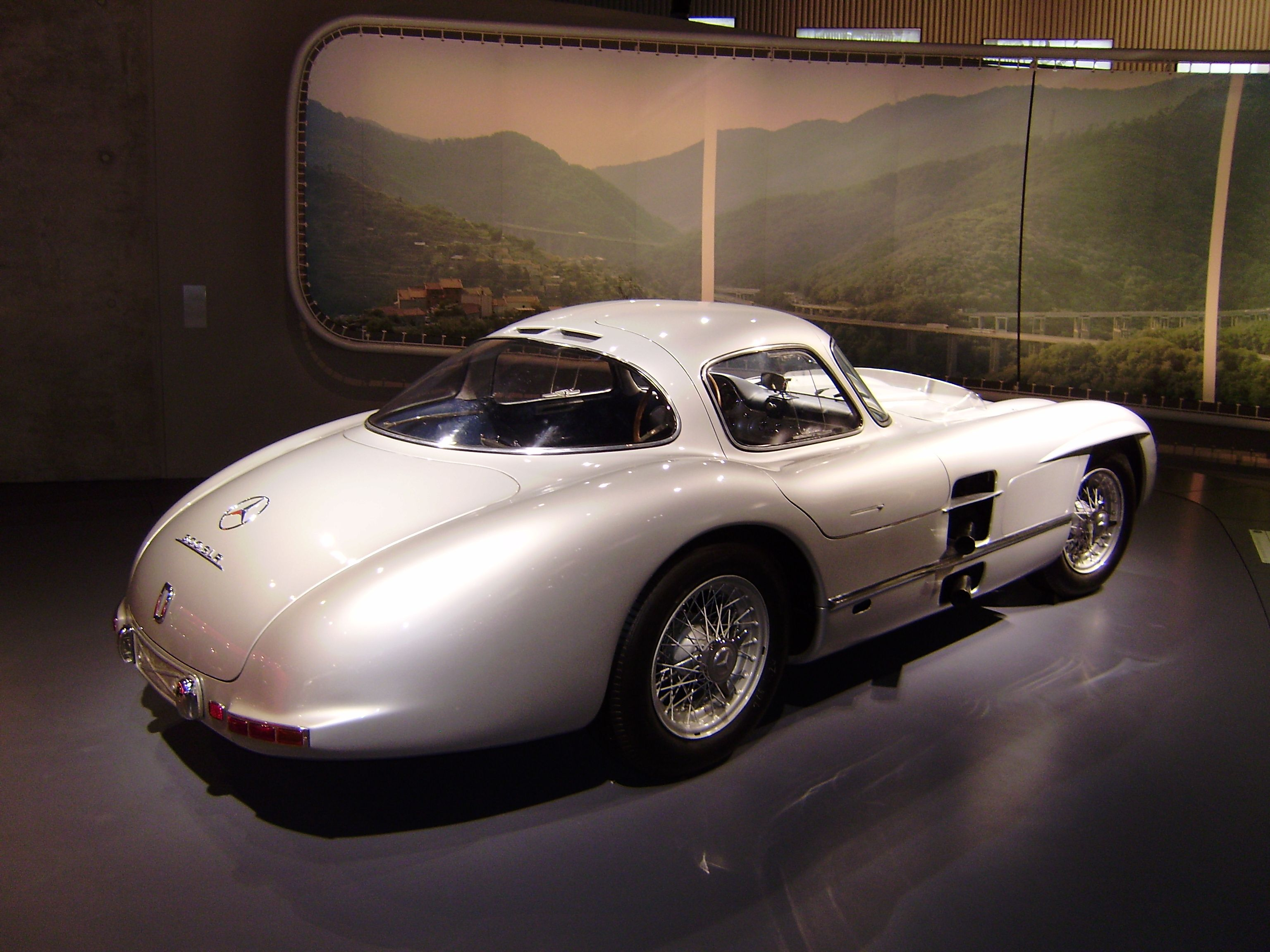 An old school sports car. Lovely! Look at the exhaust. It\'s a ...