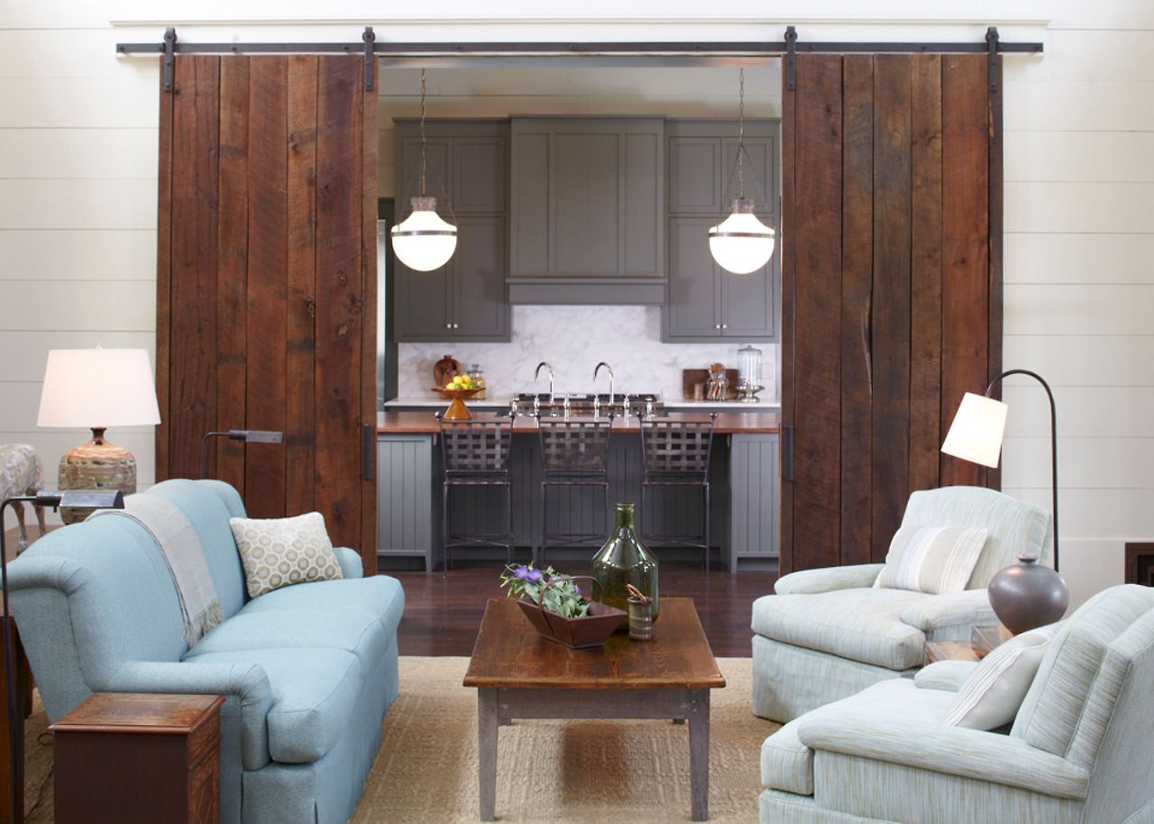 Front And Back Door Entrances Open Directly To The Sunlit Two Story Family Room With Soaring Reclaimed Wood Beam Ceilings Sliding Barn Doors That