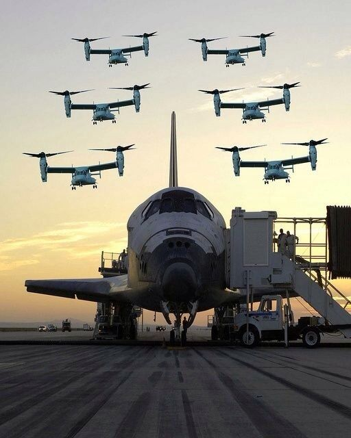 A group of MV-22 Osprey aircrafts flying over a space shuttle after a successful shuttle mission.