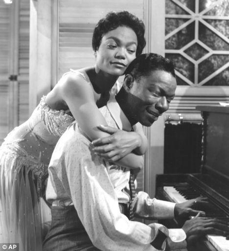 Eartha Kitt hugs Nat King Cole in a scene from the 1958 movie 'St. Louis Blues'