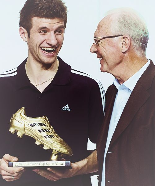 Thomas Muller With The World Cup 2010 Golden Boot And Franz Beckenbauer Germany Football Franz Beckenbauer Soccer World