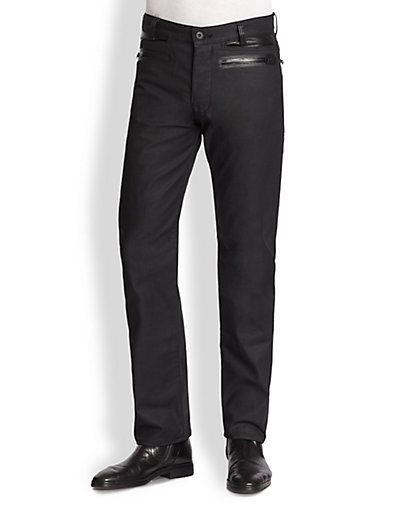Black denim jeans.  Leather belt loops and front pocket inset (rectangular pockets).  Also has front and back leather double welt zip pockets.
