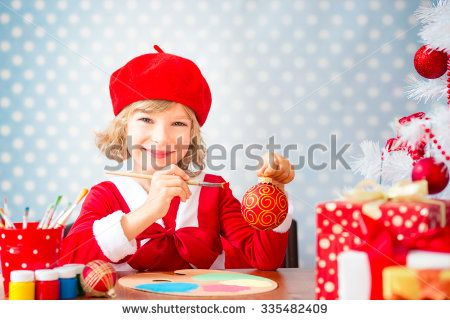 Child painting Christmas decorations. Kid playing at home. Xmas holiday concept - stock photo