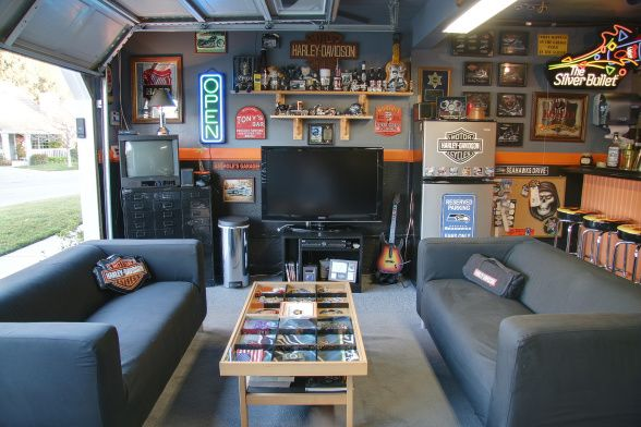 20 Cool Living Spaces Inside Of Garages Garage Game Rooms Man Cave Garage Home