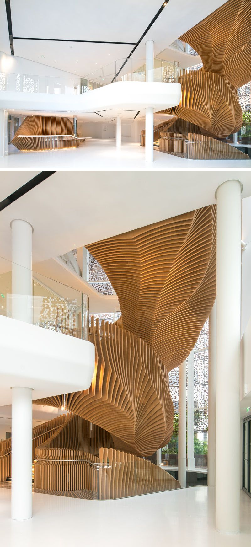 Best A Snake Like Sculptural Staircase Connects Four Floors Of 400 x 300