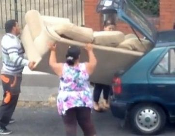 Couple tries to shove a HUGE sofa into a tiny car. HILARIOUS!!!!