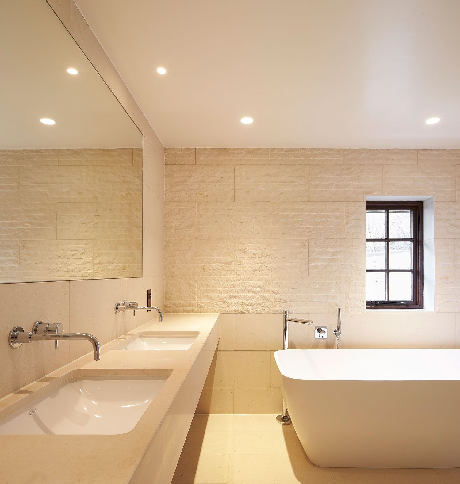 A Betiful Home Bathroom Featuring Natural Stone Floor and Wall
