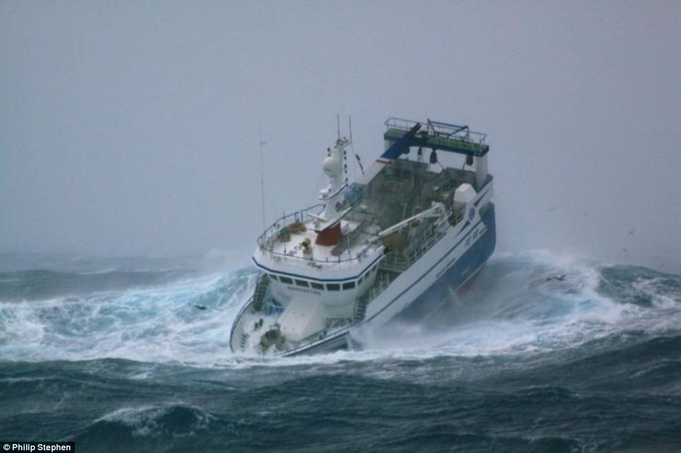 Terrifying images of fishing boat battered by 30ft waves in