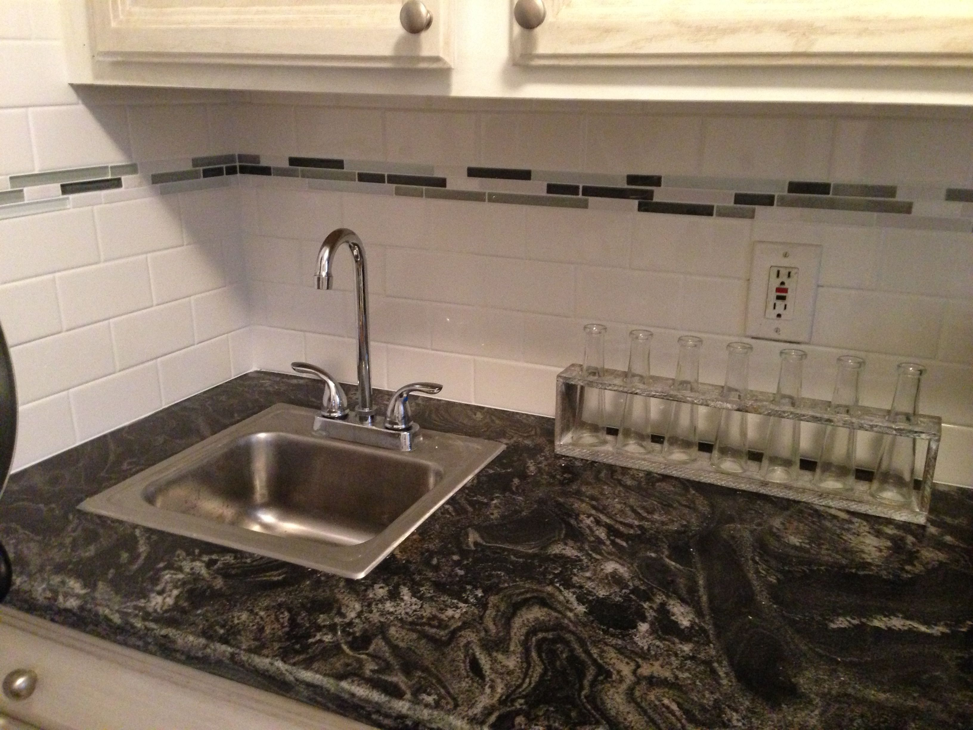 white subway tile with glass accent