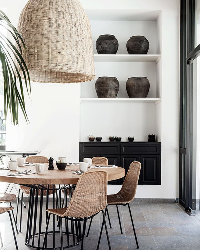 natural boho dining room with rattan elements and metal base round dining table naturalbohoc on boho chic kitchen table id=16707