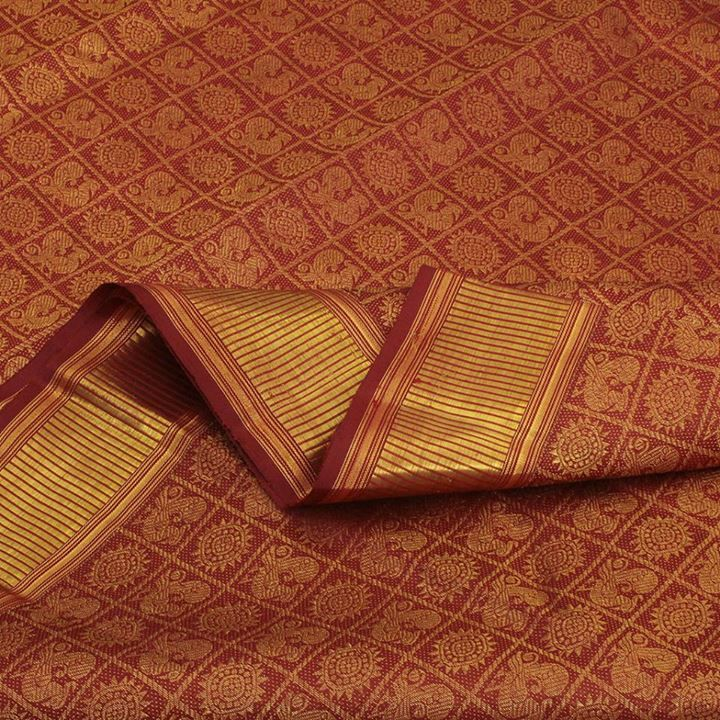 Dazzling and regal, this Sarangi silk sari is done in maroon and gold zari. Classic elements are beautifully woven into the fabric: annapakshis and suns adorn the checked body, while luminous yalis and annapakshis gracefully reign on the pallu—the entire sari lavished with fine zari. Needless to say, the zari borders are resplendent as well, making this one luxurious sari you'll definitely cherish. Code 390119025.