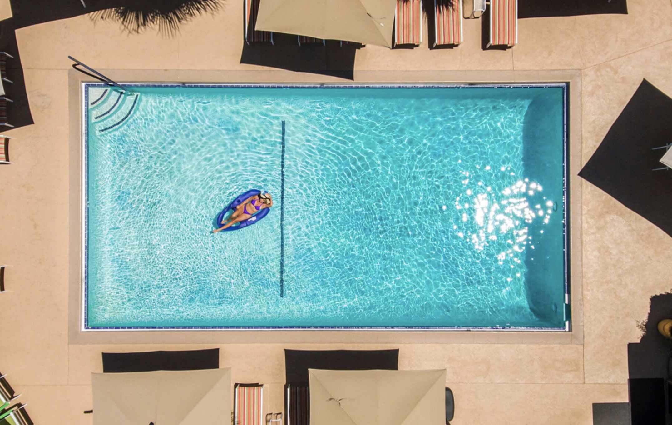 An Aerial View Of The Desert Riviera Cool Swimming Pools Palm Springs Hotels Cool Pools