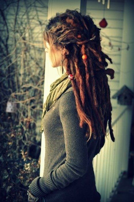 Sweater and dreads.