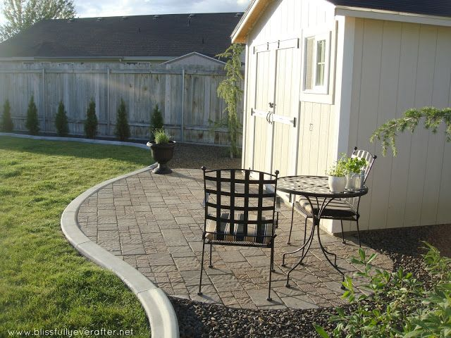 great ideaplanter around shed with pavers in front, nice