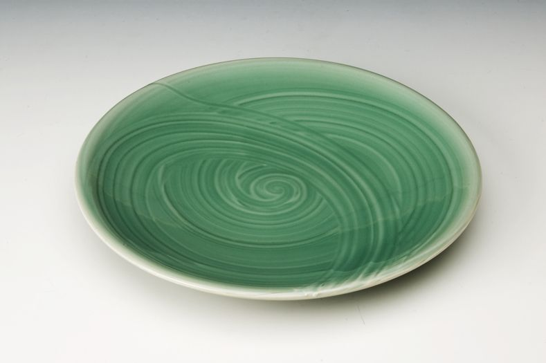 Malcolm Greenwood's plate, jigger jollied with slip decoration and transparent glaze. Learn more about the collaborative work Malcolm does with chefs, restaurants, and hotels to make a living as a working potter in the June/July/August 2015 issue of Ceramics Monthly. http://ceramicartsdaily.org/ceramics-monthly/ceramics-monthly-junejulyaugust-2015/