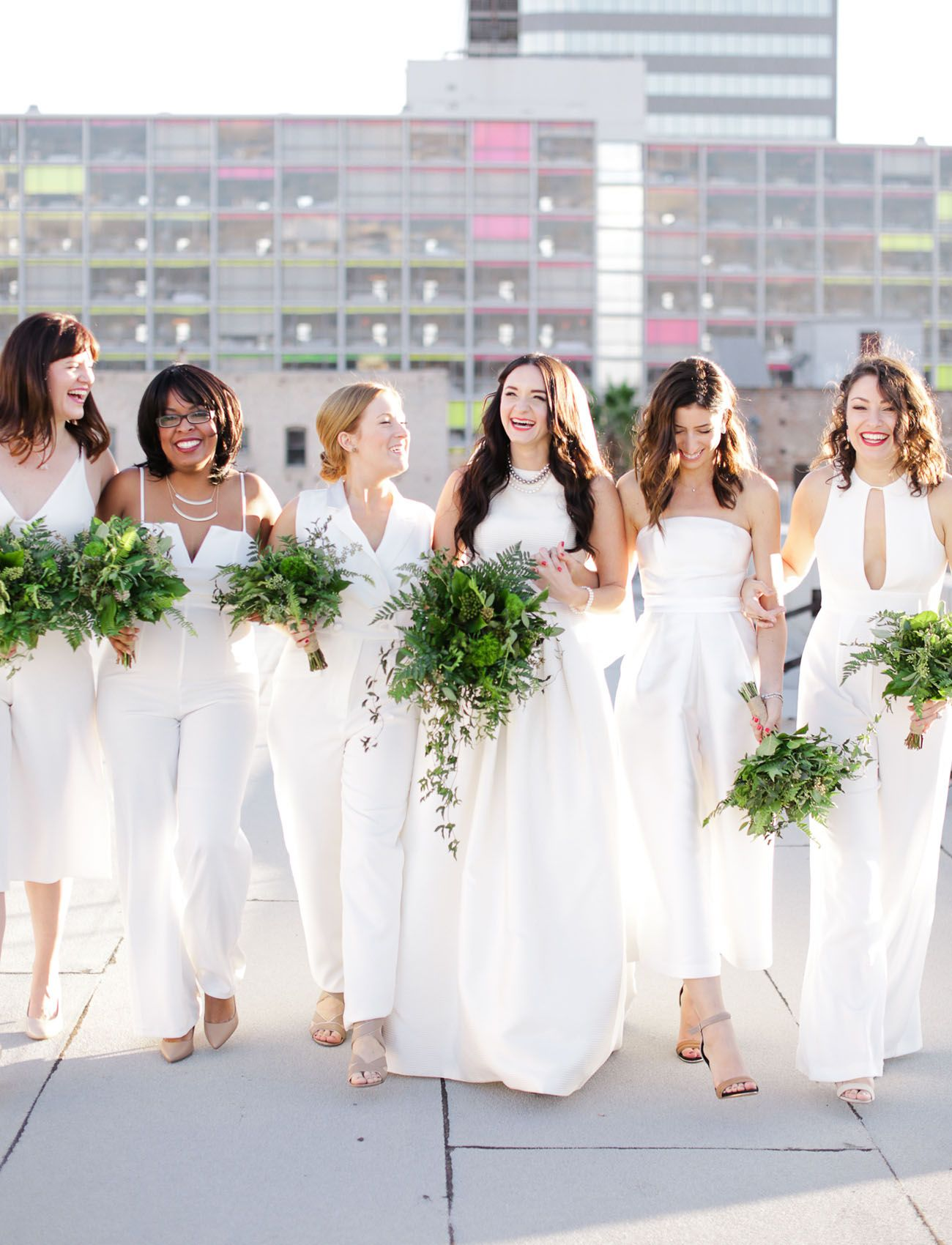 Modern los angeles rooftop wedding sara zach wedding loves these bridesmaids in white jumpsuits ombrellifo Choice Image