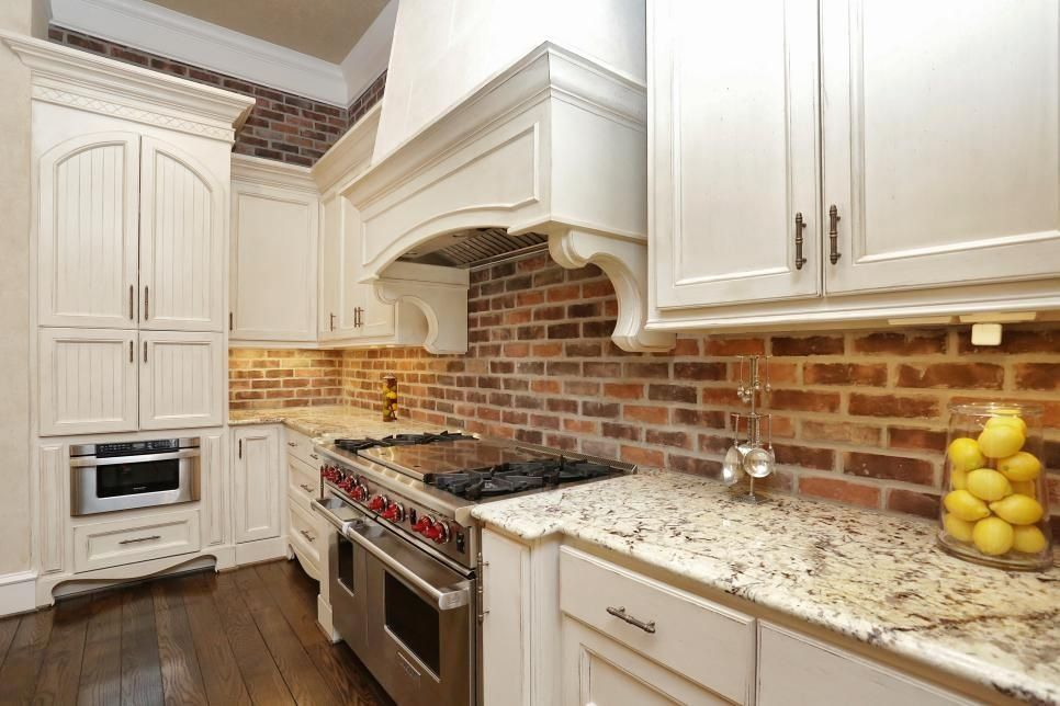 French Country Kitchen With Red Brick Accent Wall 1000 Trendy Kitchen Backsplash Brick Kitchen Backsplash Kitchen White Cabinets