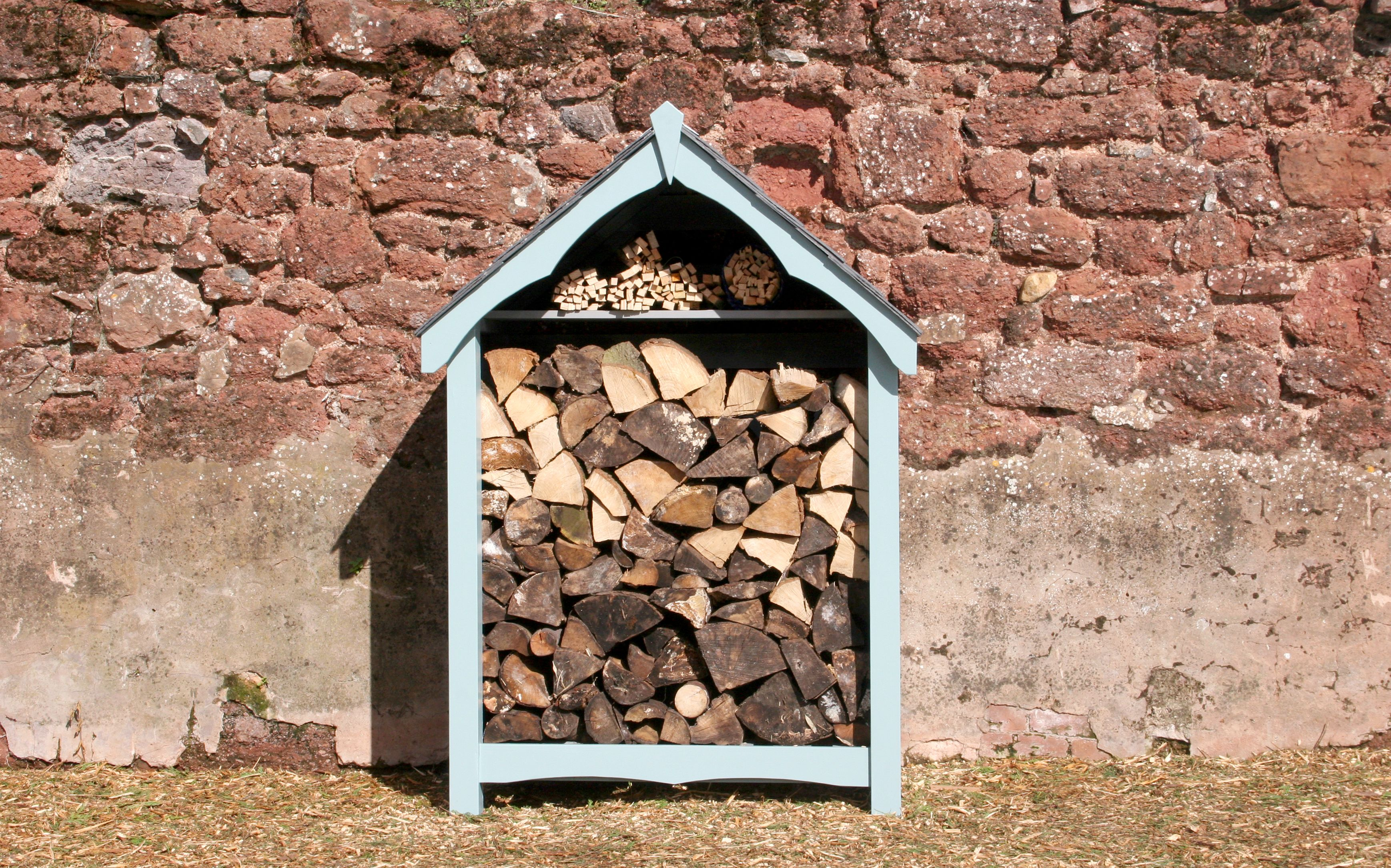 Log store with scalloped barges, finished in chalky blue.   log ...