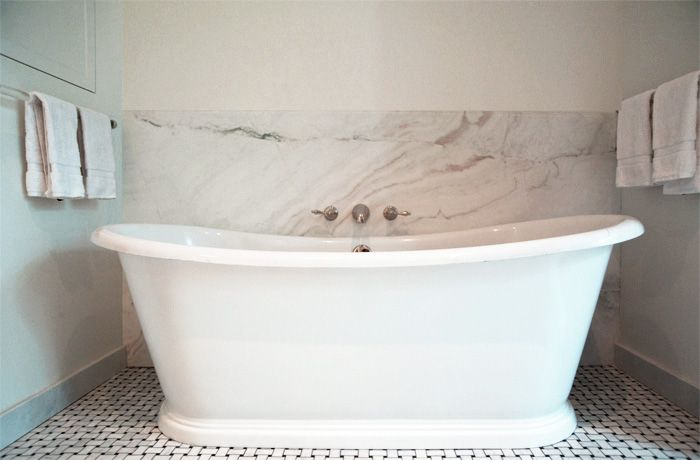 Beautiful Bath Nook With Seamless Marble Backsplash Framing A Wall Mounted Faucet Over The Freestanding Tub