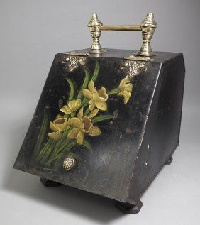 Cheerful daffodils set on a background of black toleware decorate this formerly functional coal scuttle.